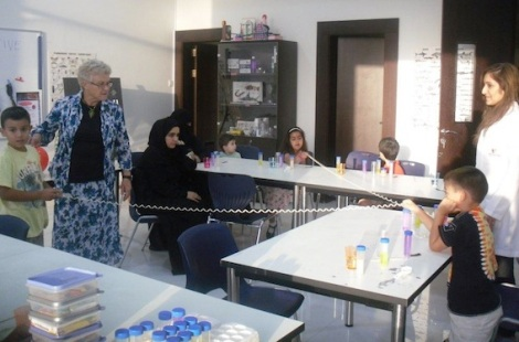 Visiting forensic scientist, Professor Valerie Corfield, explains the intricacies of the DNA spiral to young visitors to the Bahrain Science Centre during a 'DNA Detective' workshop